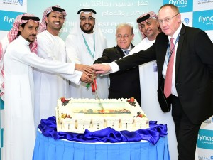 abu-dhabi-airports-and-flynas-teams-celebrate-the-commencement-of-the-new-flight